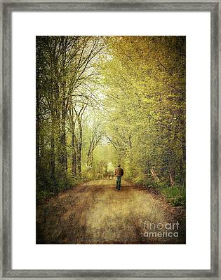 Man Walking  On A Lonely Country Road Framed Print