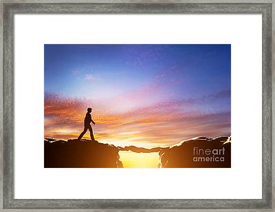 Man Walking Over Precipice Between Mountains And Another Man Being A Bridge Framed Print