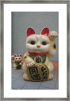 A Figure Of A Beckoning Cat, Called 'manekineko' Framed Print