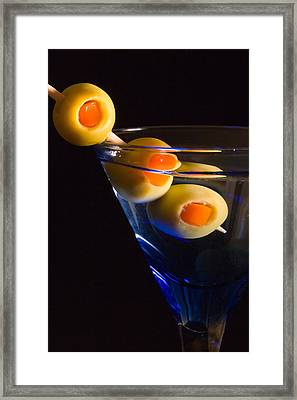 Martini Cocktail With Olives In A Blue Glass Framed Print by ELITE IMAGE photography By Chad McDermott