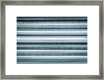 Metal Poles Framed Print by Tom Gowanlock