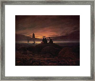 Moon Rising Over The Sea Framed Print