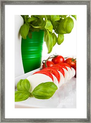Mozzarella Salad With Fresh Basil Tomatoes And Olive Oil Framed Print by Wolfgang Steiner