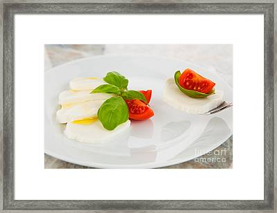 Mozzarella Salad With Tomatoes And Basil On A Fork Framed Print by Wolfgang Steiner