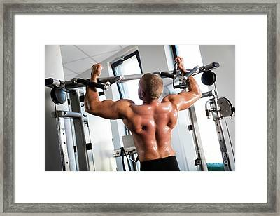 Muscular Strong Man Working Out At A Gym. Framed Print by Michal Bednarek