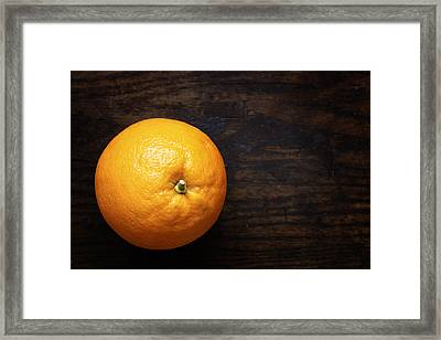 Naval Oranges On Wood Background Framed Print by Donald Erickson