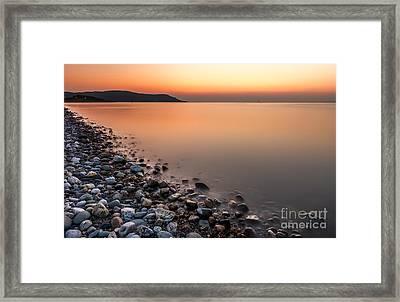 Ocean Stones Framed Print by Adrian Evans