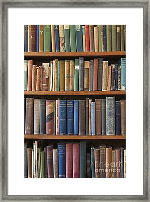 Old Books On A Bookshelf Framed Print by Paul Edmondson