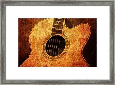 Old Guitar Framed Print by Nattapon Wongwean