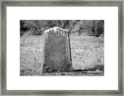 old irish milestone marker by the side of new road Enniscrone county sligo Ireland Framed Print