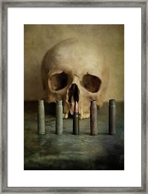 One Last Bullet Framed Print by Jaroslaw Blaminsky