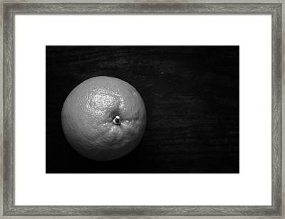 Oranges On Wood Background In Black And White Framed Print by Donald Erickson