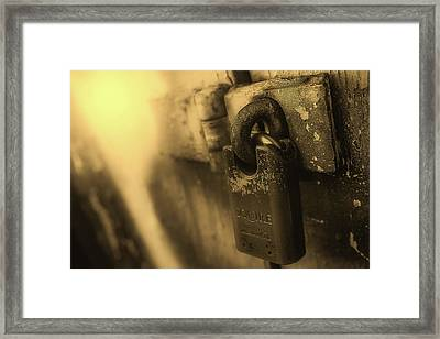 Padlock Framed Print by James Sutton