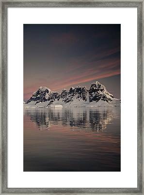Peaks At Sunset Wiencke Island Framed Print by Colin Monteath