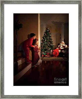 Peeking At Santa Framed Print