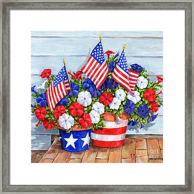 Petunias And Flags Framed Print by Paul Brent