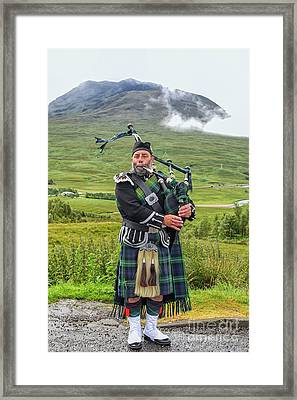 Playing Bagpiper Framed Print by Patricia Hofmeester