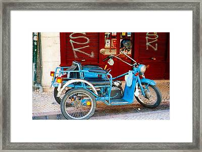 Portuguese Wheels Framed Print by Andrea Simon