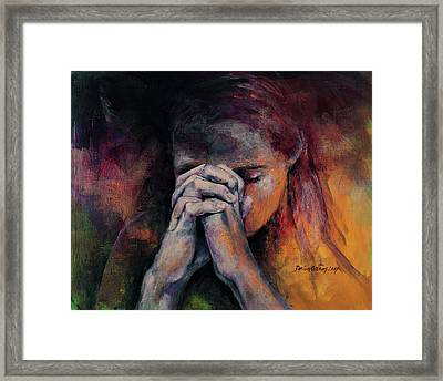 Praying Framed Print