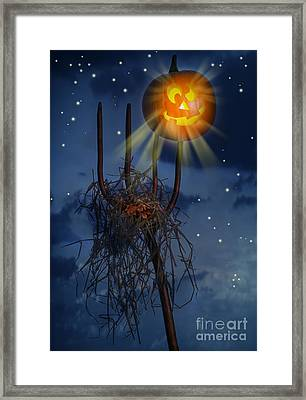 Pumpkin Sitting On Pitch Fork Framed Print by Amanda Elwell