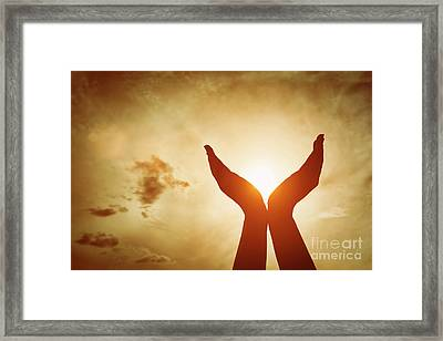 Raised Hands Catching Sun On Sunset Sky. Concept Of Spirituality, Wellbeing, Positive Energy Framed Print by Michal Bednarek