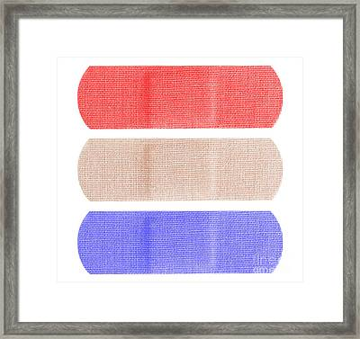 Red White And Blue Bandaids Framed Print by Blink Images