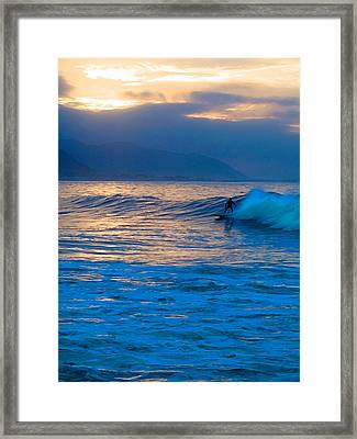 Ride At Daybreak Framed Print by Ron Regalado