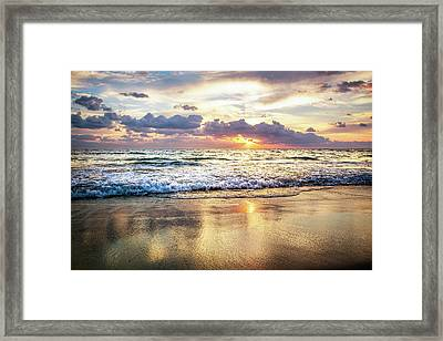 Rolling In With The Tide Framed Print by Debra and Dave Vanderlaan