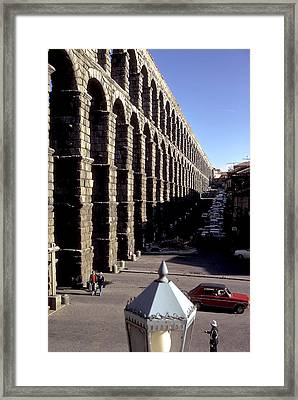 Roman Aquaduct In Segovia Framed Print by Carl Purcell