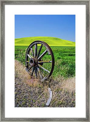 Rustic Wagon Wheel In The Palouse Framed Print by James Hammond