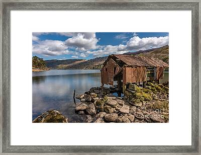 Rusty Boathouse Framed Print by Adrian Evans