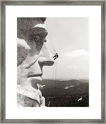 Scaling Mount Rushmore Framed Print by Granger