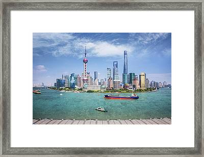 Shanghai Skyline With Modern Urban Skyscrapers Framed Print by Anek Suwannaphoom