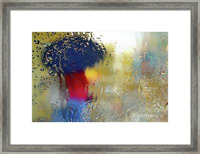 Silhouette In The Rain Framed Print