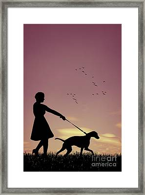 Silhouette Of Woman Walking Her Dog Framed Print by Amanda Elwell