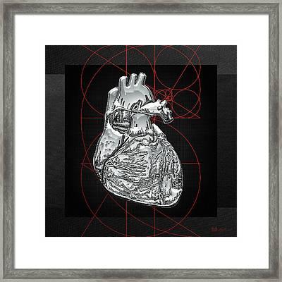 Silver Human Heart On Black Canvas Framed Print by Serge Averbukh