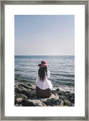 Sitting At The Sea Framed Print by Joana Kruse