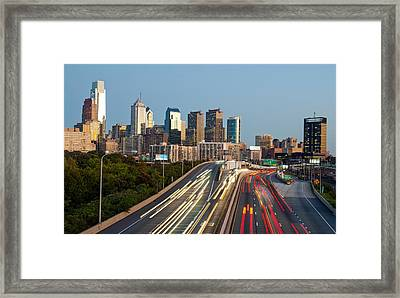 Skyscrapers In A City At Dusk Framed Print by Panoramic Images
