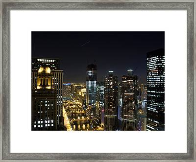 Skyscrapers In A City Lit Up At Night Framed Print by Panoramic Images