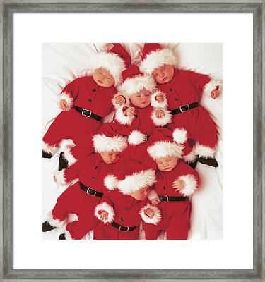 Sleepy Santas Framed Print