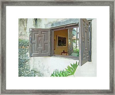 Spanish Windows Framed Print by Gary Wonning