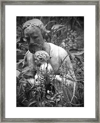 Statue In Flowers Framed Print by Megan Verzoni