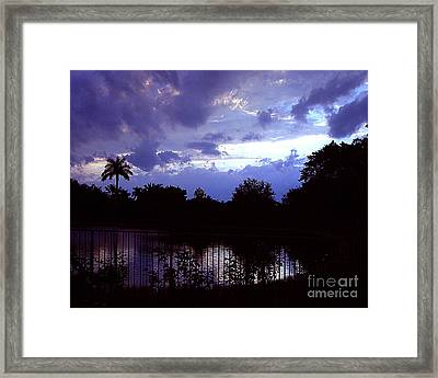 Storm Clouds Gather Framed Print by Merton Allen