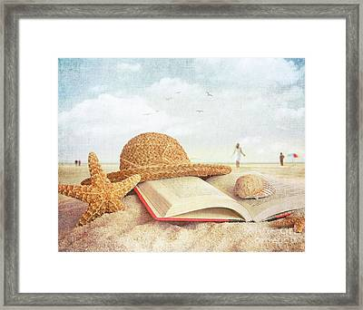 Straw Hat Book And Seashells In The Sand Framed Print