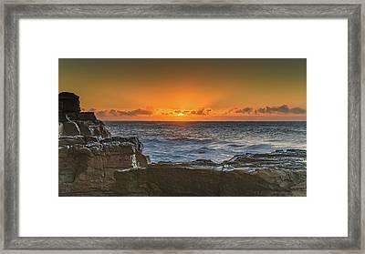 Sun Rising Over The Sea Framed Print