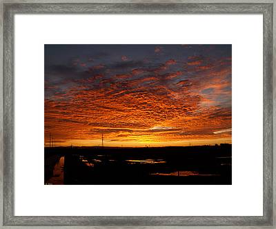 Sunrise Framed Print by Arik Baltinester