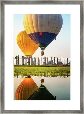 Sunrise At U Bein Bridge Framed Print by Anek Suwannaphoom