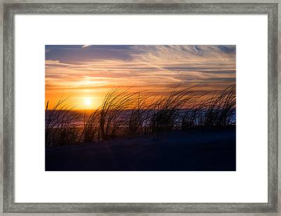 Framed Print featuring the photograph sunset at the North Sea by Hannes Cmarits