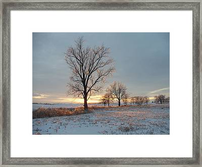 Sunset Over Icy Field Framed Print