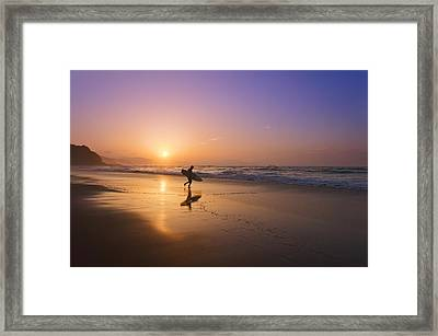 Surfer Entering Water At Sunset Framed Print by Mikel Martinez de Osaba